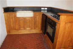 It's fully equipped with stone sink, brass taps, fridge, gas oven and hob