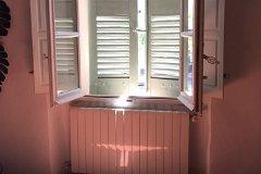 Summer sunshine through the salon shutters.