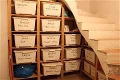 At the base of the second 'concealed' staircase is the stock room for the linen