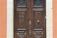 The front door - noble, majestic, with solid brass fittings.