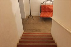 Stairs leading upstairs from the entrance hall on the ground floor