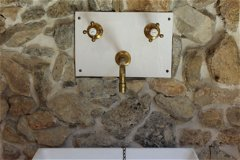 Bespoke hand basin and wall plate made and signed by the master potter who has a shop next door.