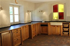 The kitchen looks on to the courtyard and has room enough for 10 to prepare meals together