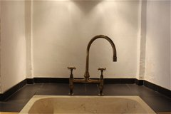 One of two Spanish stone kitchen sinks with solid brass taps from the UK