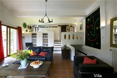 Villa - lounge area and galleried kitchen