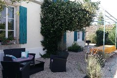Les Boulins (sleeps 10) poolside terrace with tables, bbq and comfortable seating