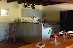 Les Boulins (sleeps 10) kitchen from pool terrace door
