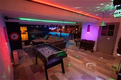 State of the art entertainment space with full sized bar