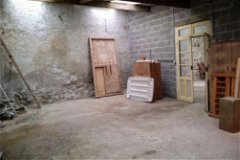 Garage 1, access to grenier, boiler room, cave. Potential workshop