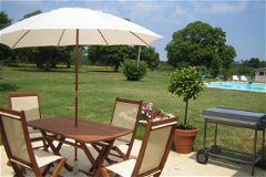 2 bedroomed Cottage patio overlooking the pool