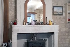 Lounge stone fireplace with woodburner