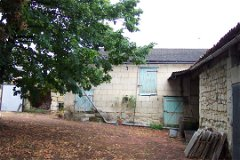 back of outbuilding and outer courtyard