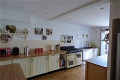 Farmhouse style kitchen, range cooker, double pantry & utility room with 11kg washing machine