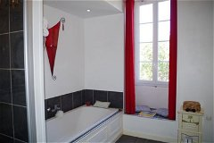 Parent Suite Bathroom with oversized tub, walk-in shower, dual sinks, private toilet, floor heating