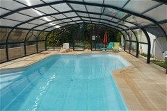 12 by 6 metre swimming pool completely covered or slide open the windows in hot sun