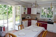 kitchen with open door to front garden