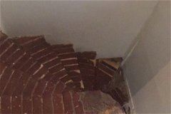 Spiral brick stairs to bedrooms and upstairs bathroom