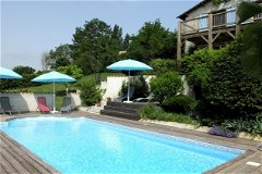 solar heated pool for La Grange and enclosed planted garden