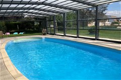 The heated and covered swimming pool