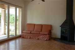 Lounge with balcony, 2 of these picture windows and fireplace