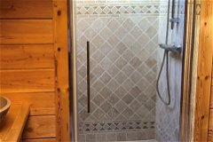 Large fully tiled shower with seat