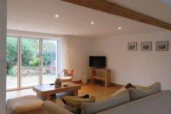 open plan living area with bifold doors