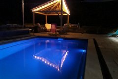 Swimming pool at night with coloured lights