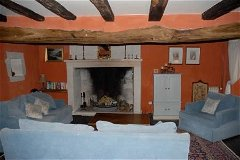 Sitting room with 17th century fireplace and original medieval oak floor