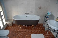 En-suite bathroom with power shower and antique roll top bath