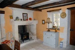 Spacious dining room with ancient fireplace and woodburning stove