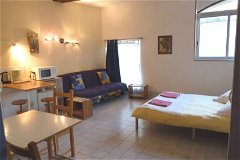 Downstairs studio apartment. Bright, colourful and popular!