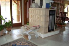 hall with tiled insert woodburner