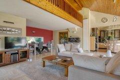 Living room overlooked by mezzanine