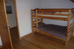 Bunks plus third single bed to left