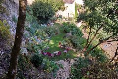 High view of the garden and house at No3 with the Chateau behind